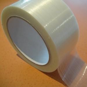 Adhésif de réparation renforcé de fibres de verre